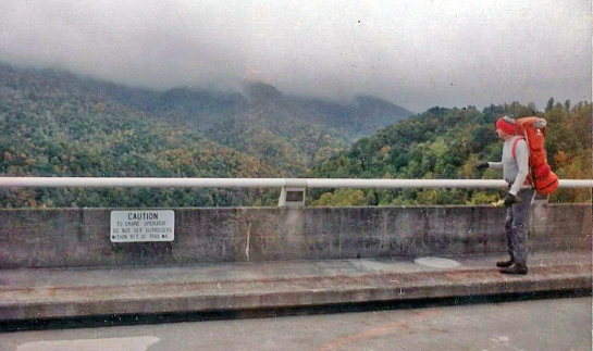 My cousin Jim Criner crossing Fontana Dam in 1989 after 25 miles in three days, Smokies