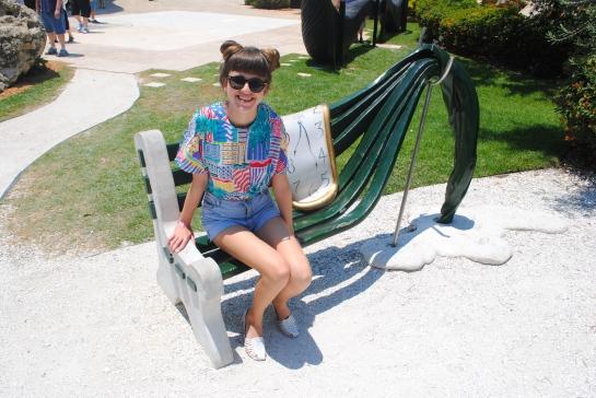 Elizabeth sitting on a Dali bench, St. Petersburg.