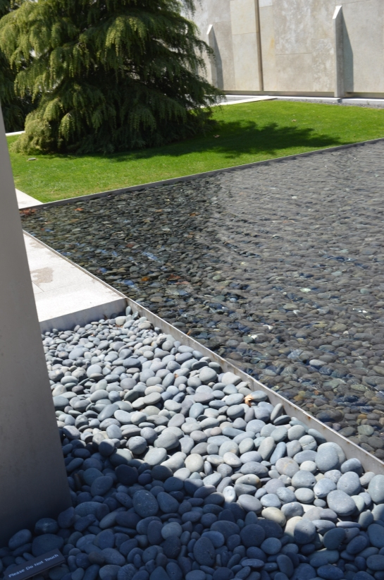 City abstract, shallow fountain with river stones