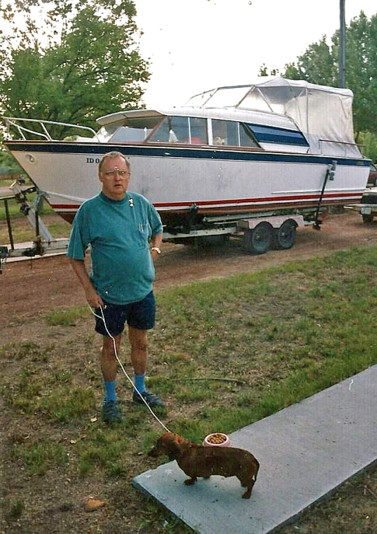 My dad, the late Dr. Roger K. White and the cabin cruiser we moved from Idaho to Tennessee.