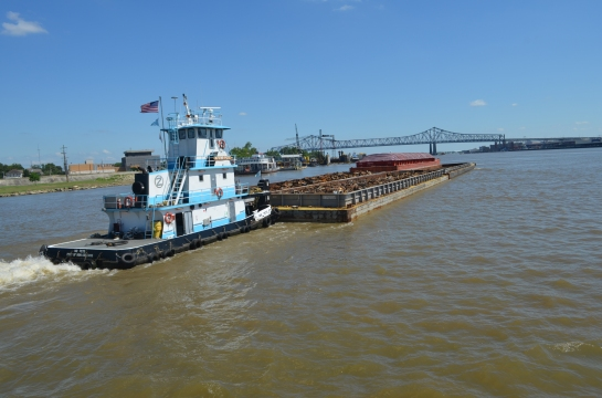 Barge having trouble making headway against the Mississippi River current at New Orleans